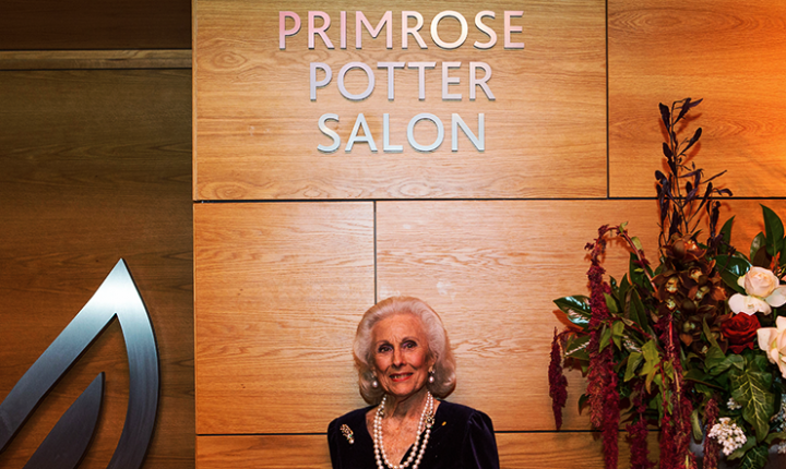 Lady Primrose Potter standing outside the entrance of the Salon